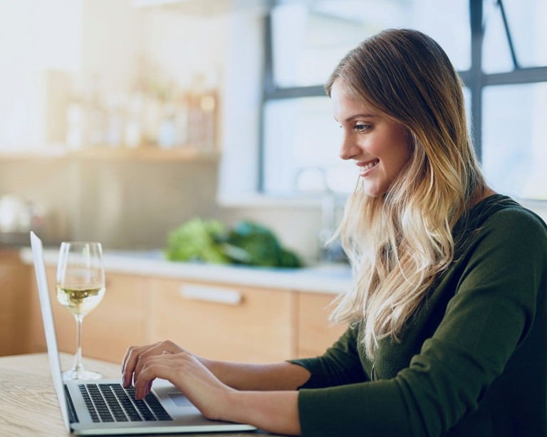 Woman sitting at a table with laptop