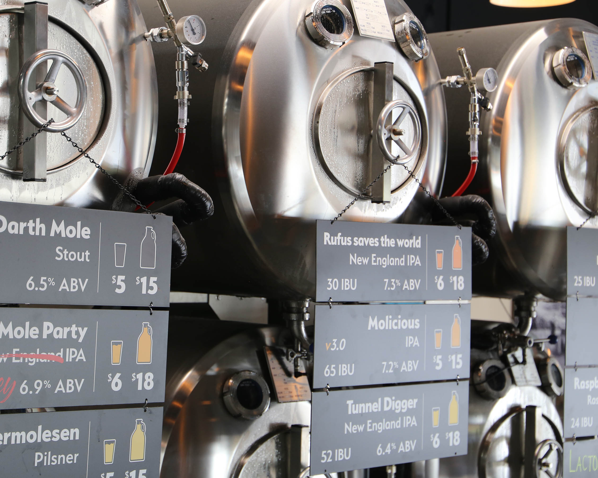 Kettle with signs indicating which beer is in which kettle
