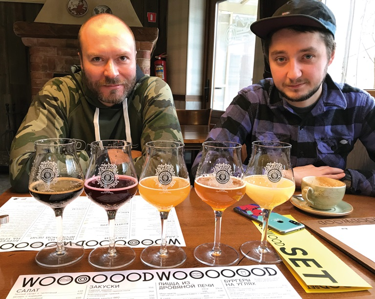 Andrei Ivanov (l.) and Ren Sharafview in front of beer glasses with different beers, ready for tasting