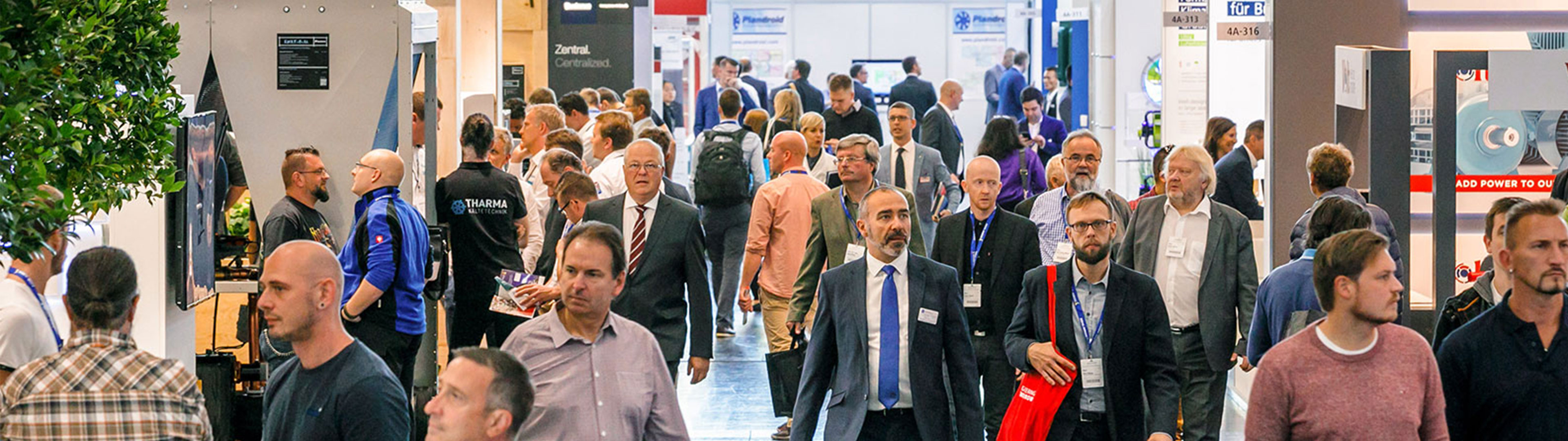Visitors walk in the hall aisle between exhibition stands at Chillventa.